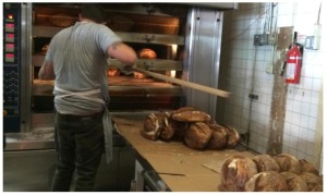 Hot loaves of country bread coming out of the oven at Tartine Bakery